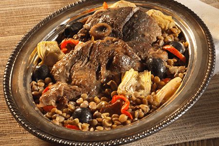 Braised Lamb with Lentils, Bacon, Artichokes and Olives