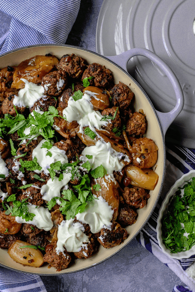 A pot of lamb meatballs with yogurt, and mint