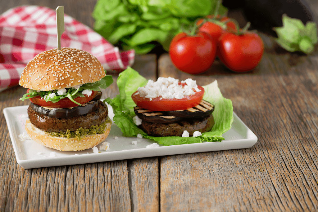 Grilled burgers are a summertime classic. Change it up by adding eggplant, basil pesto, and crumbled goat cheese for a Mediterranean flair.