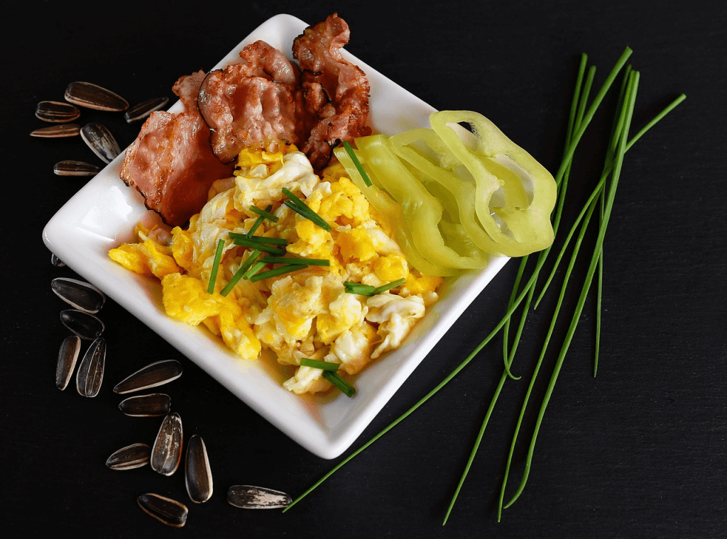 Eggs, bacon, peppers, and seeds are just some of the things you can eat on the keto diet.]
